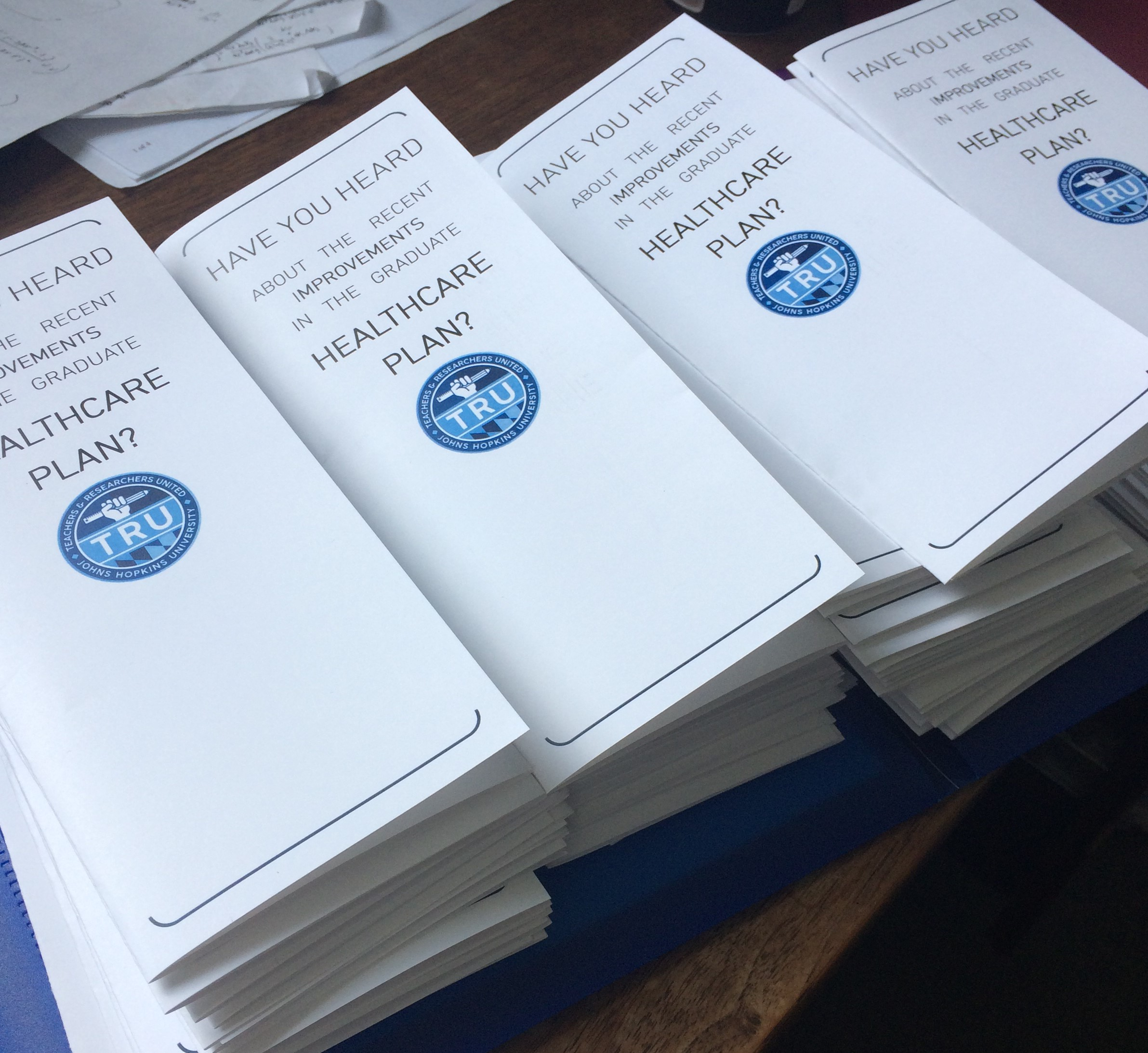 piles of pamphlets about changes to the CHP health care plan